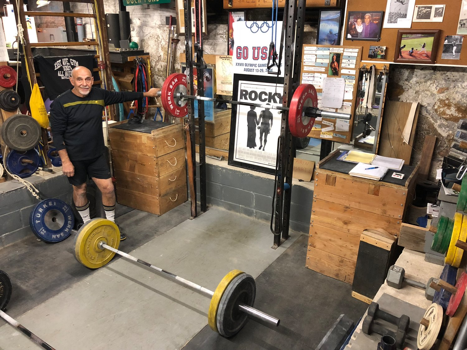 Landry with the squat rack in the weightlifting pit he dug into his basement floor.