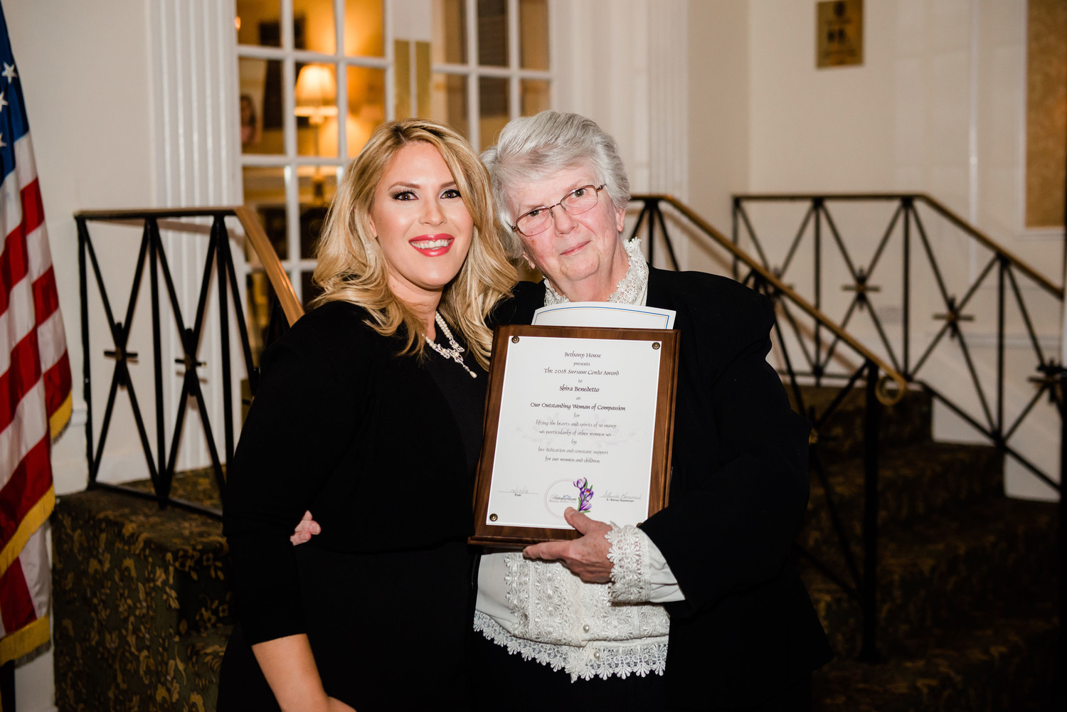 Oceanside resident Shira Benedetto, right, was honored with the Outstanding Woman of Compassion plaque by Sister Aimee Koonmen, the founder and executive director of Bethany House.