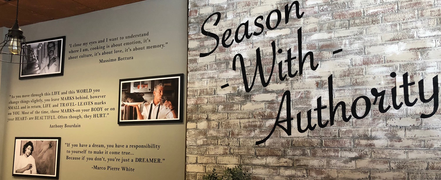 "The redesigned dining room features quotes from world-famous chefs like Anthony Bourdain and Massimo Bottura and the restaurant's motto, ""Season With Authority."""