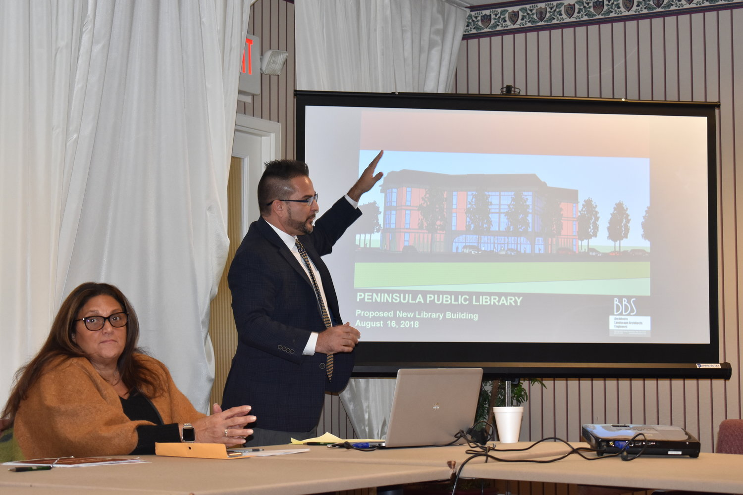 Kevin Walsh, a partner at BBS Architecture, reviewed the latest changes to the plan for a new Peninsula Public Library. Carolynn Matulewicz, the library's director, answered questions at the meeting.