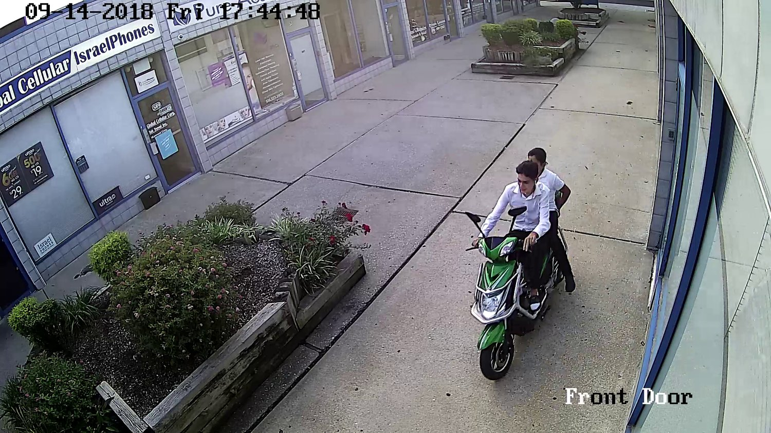The driver and passenger on a green electric motorized scooter that allegedly struck a 54-year-old man on Central Avenue in Cedarhurst on Sept. 14.