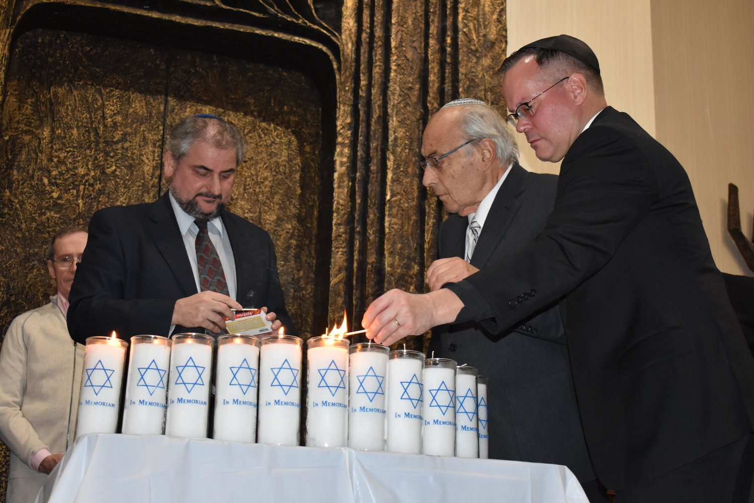 Candles were lit for each of the victims of the shooting at the Tree of Life Synagogue in Pittsburgh, from left, Rabbi Claudio Kupchick of Temple Beth El, center, Rabbi Arnold Marans of the Sephardic Temple and Father Christopher Ballard of Trinity-St. John's Episcopal Church.