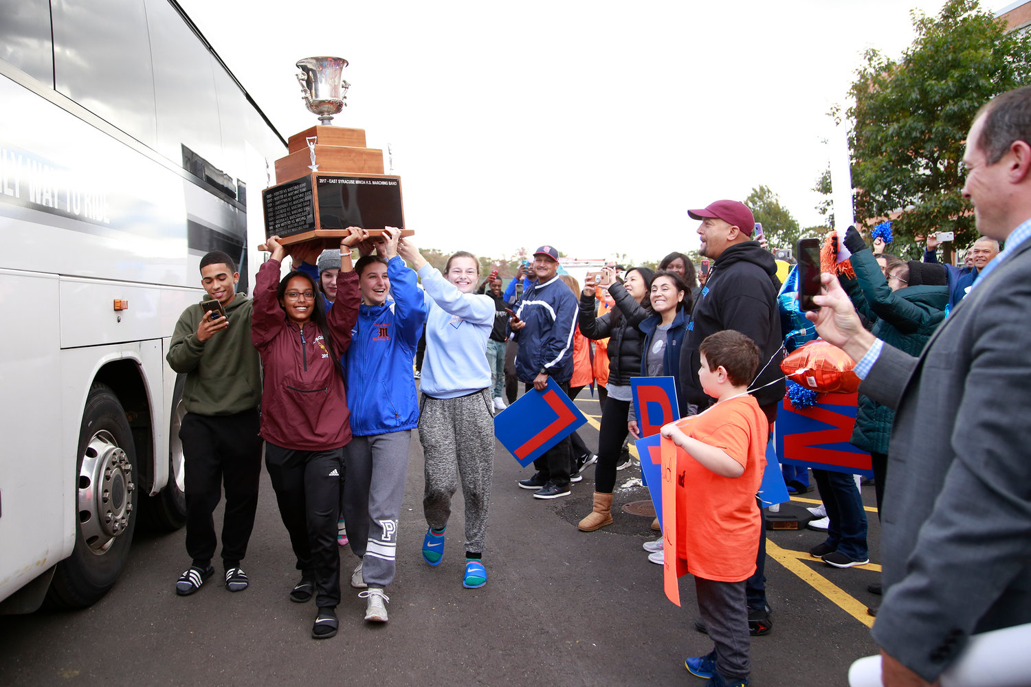 The Pride of Malverne Marching Band hoisted their trophy as parents, students and faculty members congratulated them at Malverne High School on Oct. 29.