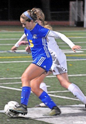 East Meadow's Rachel Rose controlled the ball along the sideline during the Nassau Class AA championship game, won by Syosset on penalty kicks.