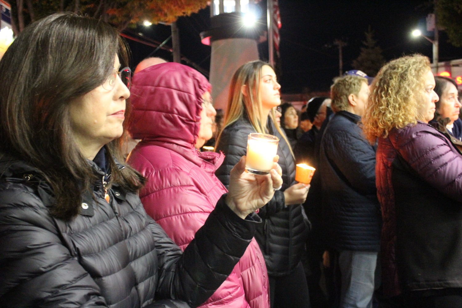 Residents held lit candles throughout the ceremony.