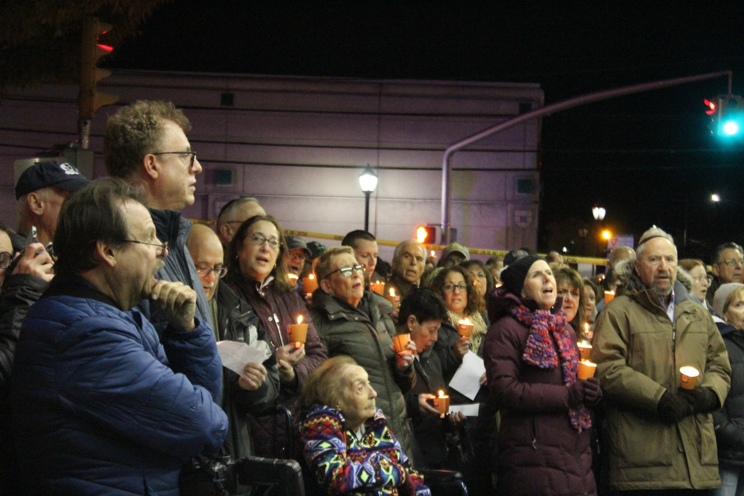 "The vigil included the singing of two Jewish hymns, ""Oseh Shalom Bimromav"" and ""Hineh Ma Tov."""