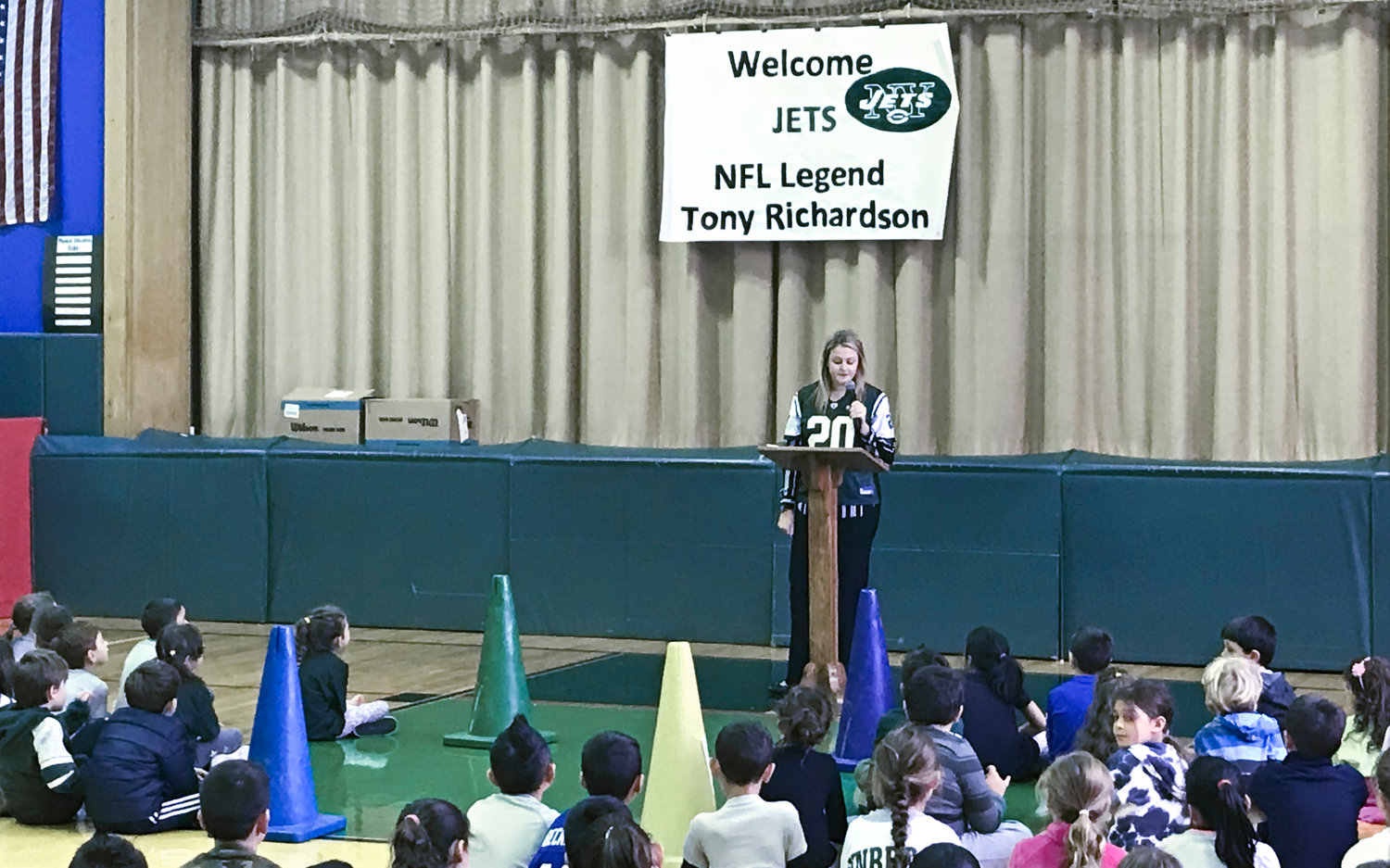 Principal Allison Banhazl wore a Jets jersey to welcome Richardson to the school.