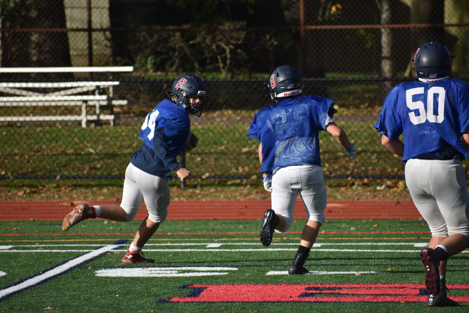 Medford, left, got ready to evade a tackler before scurrying down the sideline during a practice on Oct. 29.