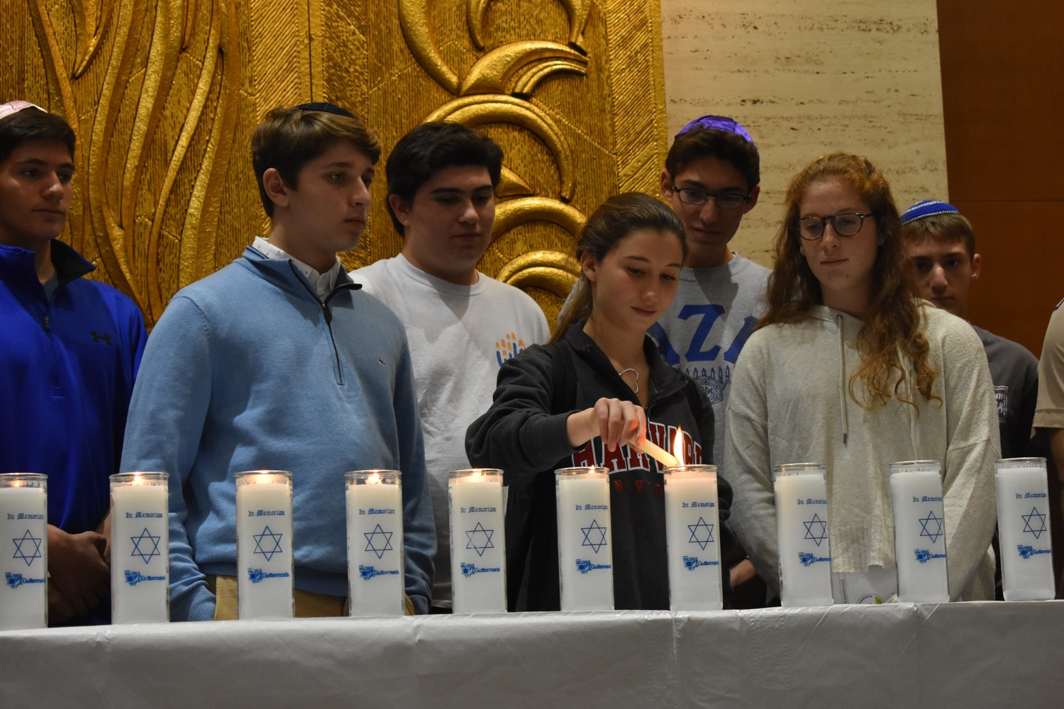 Student leaders of B'nai B'rith Youth Organization and members of Boy Scout Troop 214 lit candles in memory of the 11 people killed during a shooting at the Tree of Life Congregation synagogue in Pittsburgh's Squirrel Hill neighborhood on Oct. 27.
