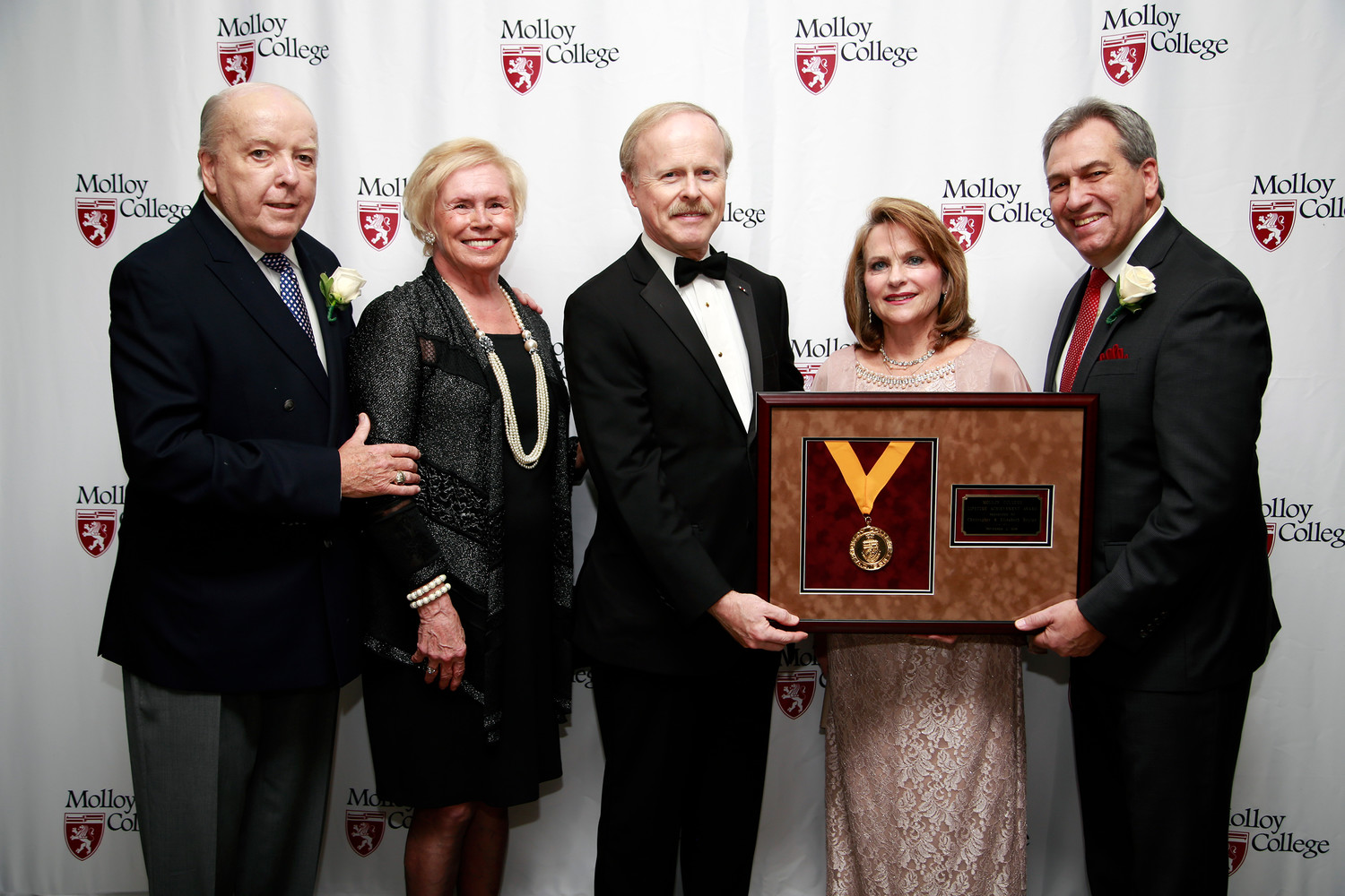 Paul Durman, from left, Molloy College Chairman Emeritus and Sherry Durman joined Christopher and Elizabeth Boylan, recipients of the Lifetime Achievement Award, and Molloy College President Drew Bogner.