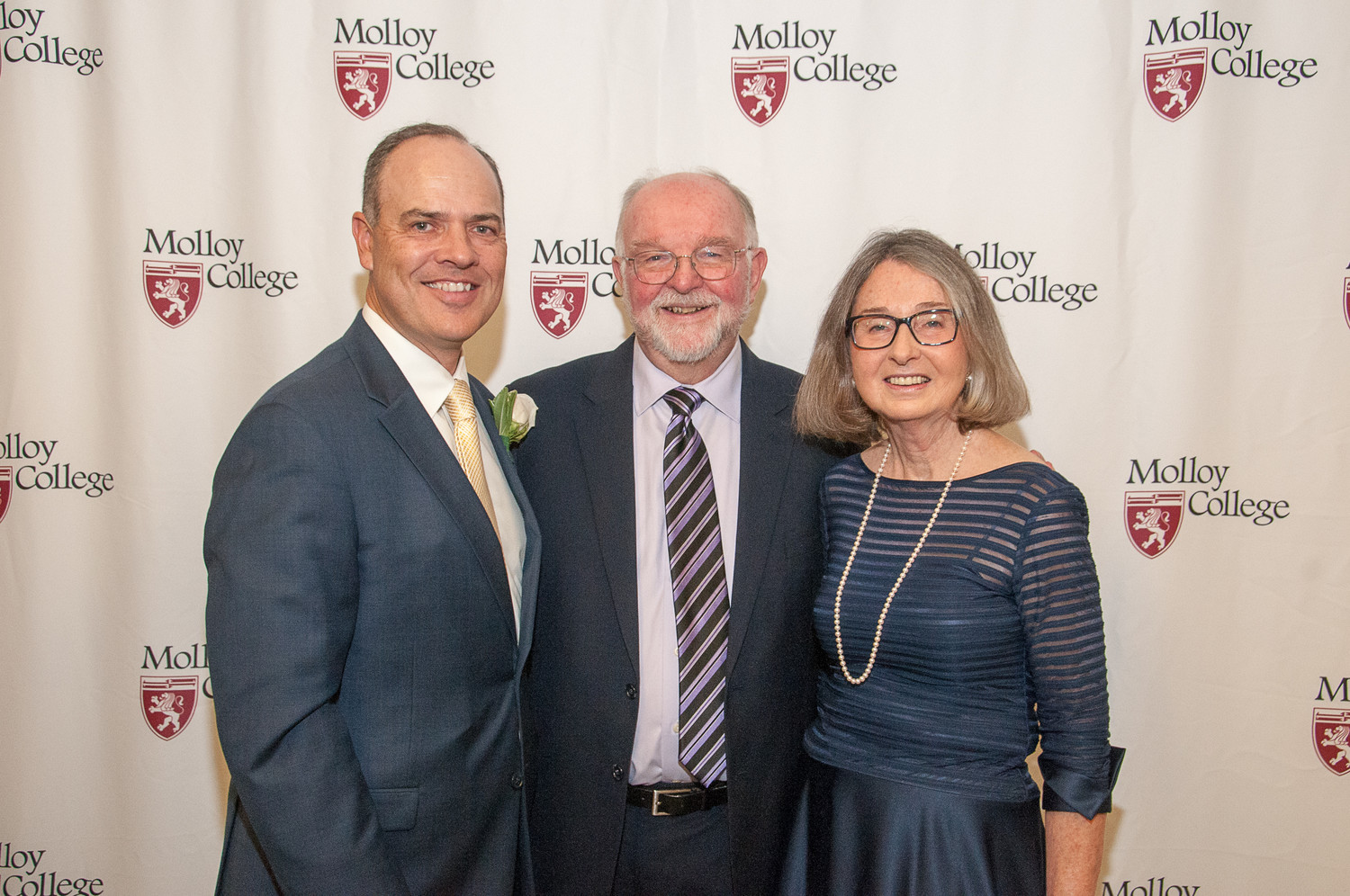 Edward J. Thompson, vice president of advancement at Molloy, left, with Jim and Valerie Collins. Valerie was a Distinguished Alumni Award recipient.