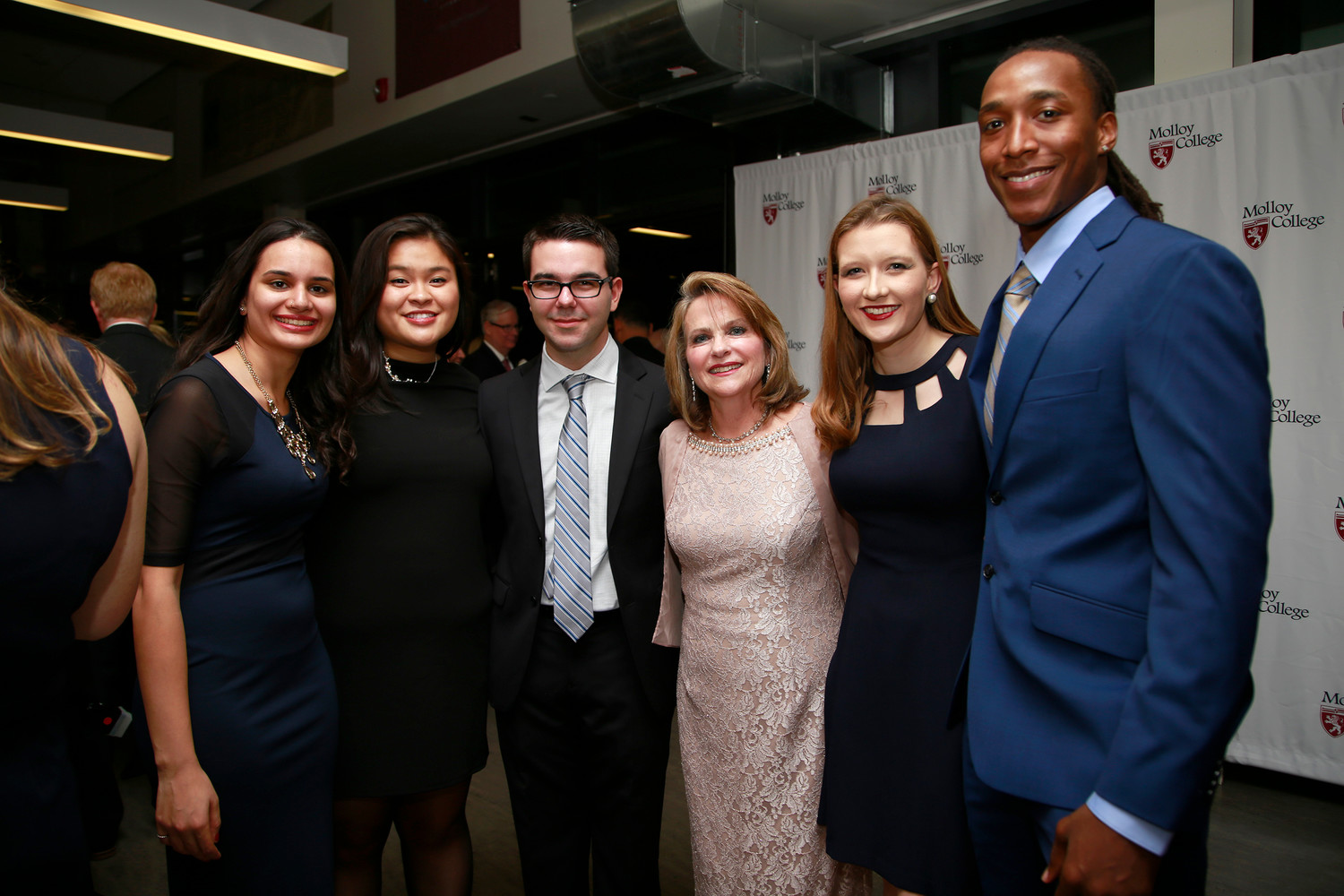 Honoree Elizabeth Boylan with Molloy students Afsha Malik, left, Helen Pham, Lucijan Jovic, Anne Collins, president of the student body, and Curtis Jenkins.