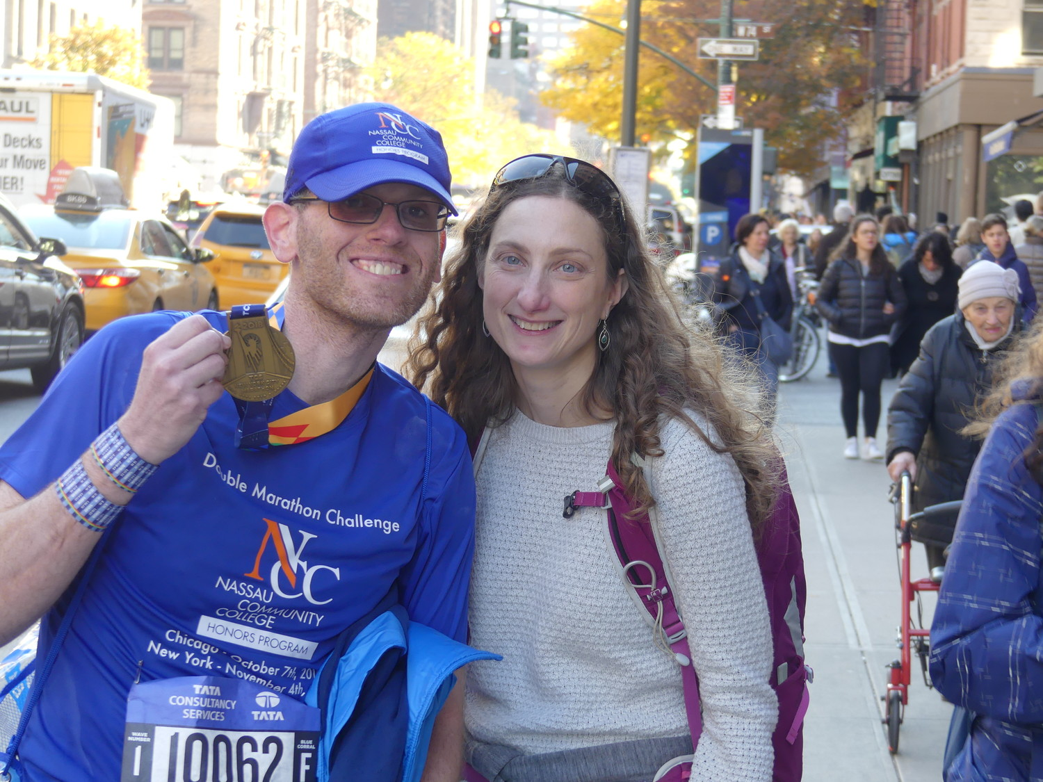 Richard Cohen, with his wife, Stacey Schwarcz, proudly flashed the medal he received for completing the TCS New York City Marathon to raise funds for scholarships for his students at Nassau Community College.