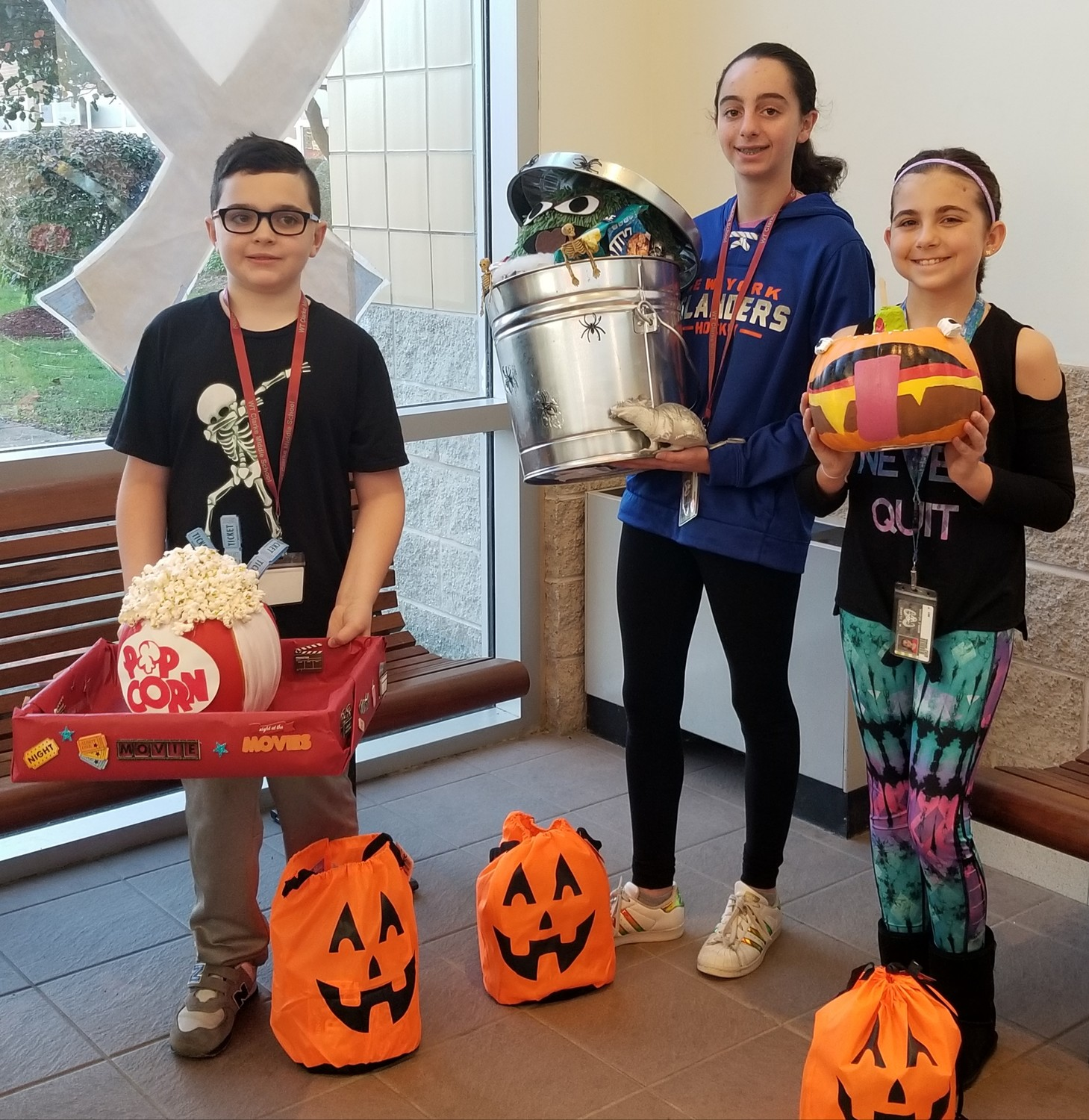 Connor Jones, a sixth-grade student at W.T. Clarke Middle School, left, Juliet Cimaglia, a seventh-grade student, and Shay Genna, a sixth-grade student, were awarded top prizes during the school's second annual pumpkin contest.