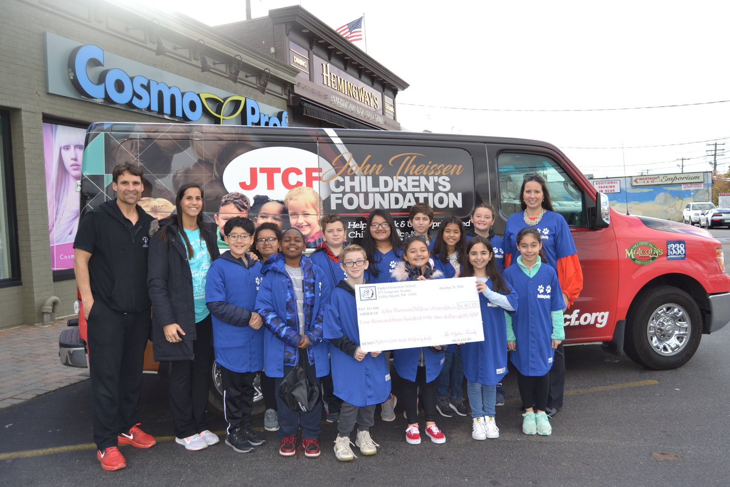 Ogden Elementary School fifth-graders helped deliver money and toys to John Thiessen, far left, and his Children's Foundation. On the left is physical education teacher Rosemarie Ryan and at the far right is social worker Gina Carrillo.