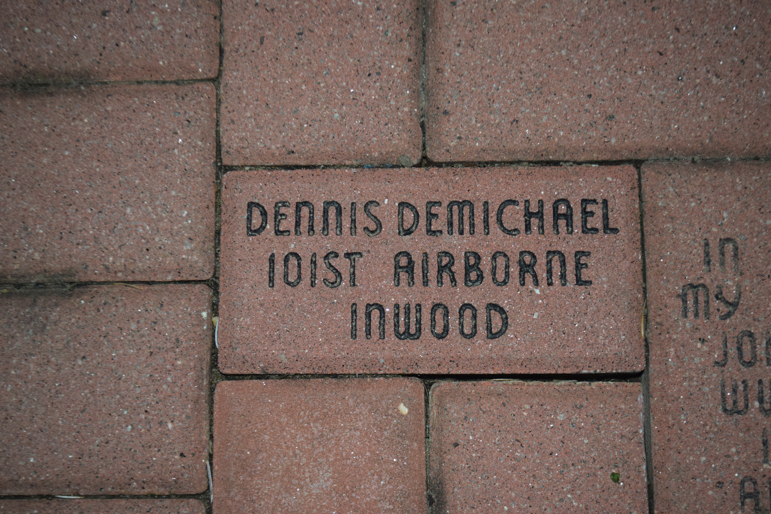 The brick in memory of Dennis DeMichael is among several that adorn the walkway by the veterans memorial in Andrew J. Parise Cedarhurst Park.