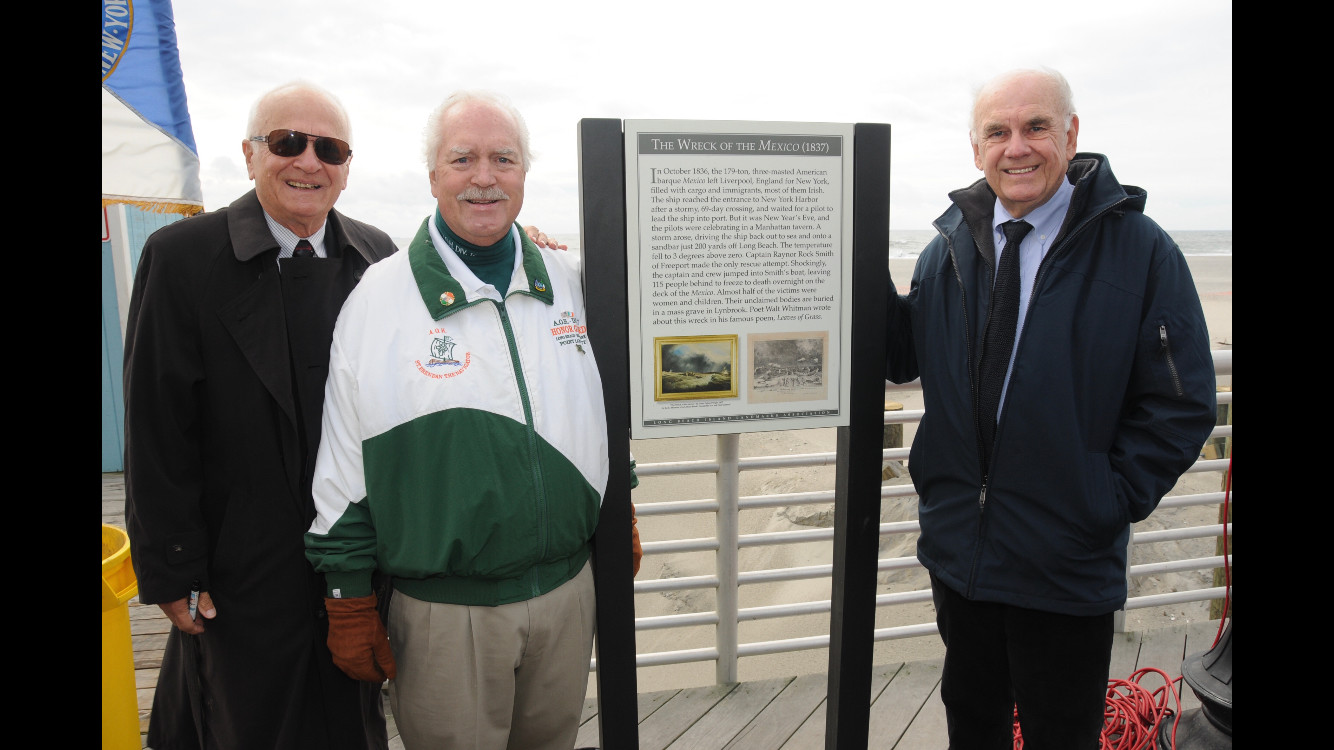 Art Mattson, of the Historical Society of East Rockaway and Lynbrook, left, Andrew Healey, chairman of the Nassau County Ancient Order of Hibernians Charities and Missions Program, and Doug Sheer, co-chair of the Long Beach Island Landmark Association, unveiled a plaque to commemorate the shipwreck of the Mexico on the boardwalk on Oct. 20.