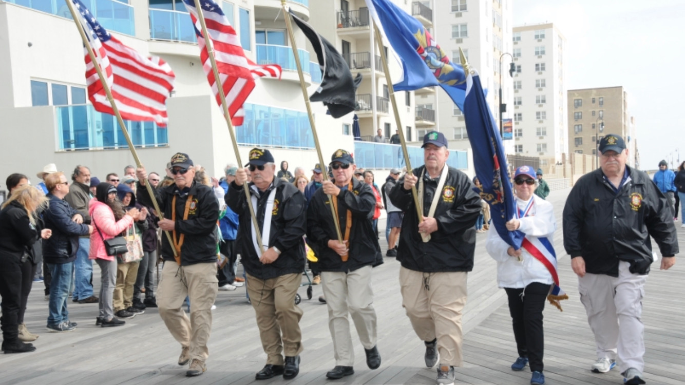 Members of the color guard for the Veterans of Foreign Wars Post 1384 made their way down the boardwalk.