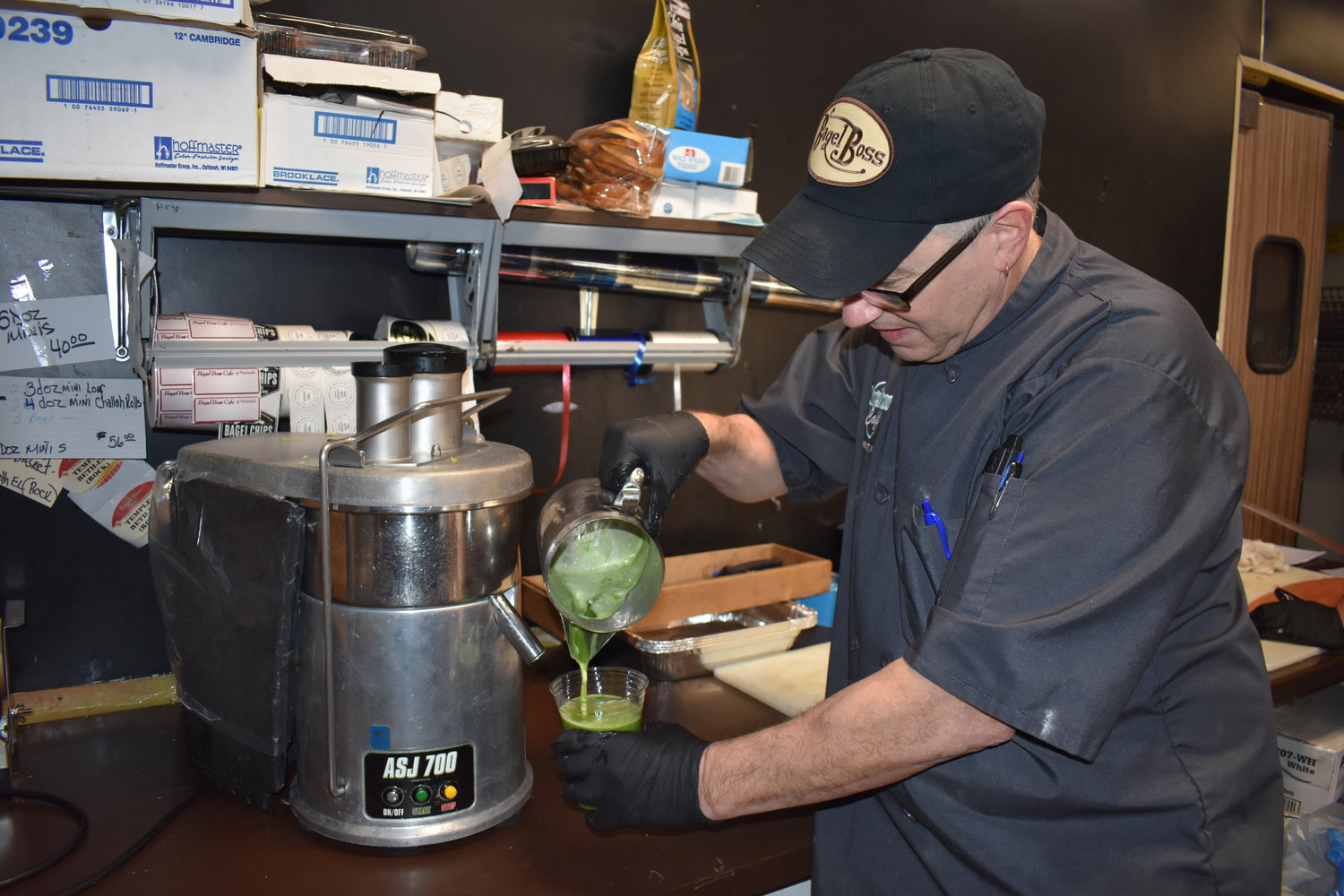 Randy Rosner mixes kale, green apples, celery and lemons together to make a delicious and nutritious juices for the Bagel Boss clientele.