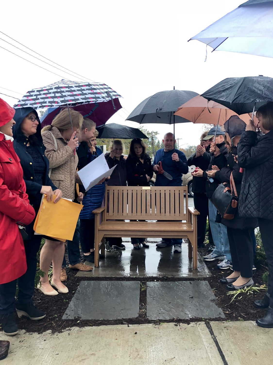 The Gonder family, center, were present during the Gold Coast Business Association's bench dedication on Monday. The bench is dedicated in memory of former local business owner Charles Gonder.