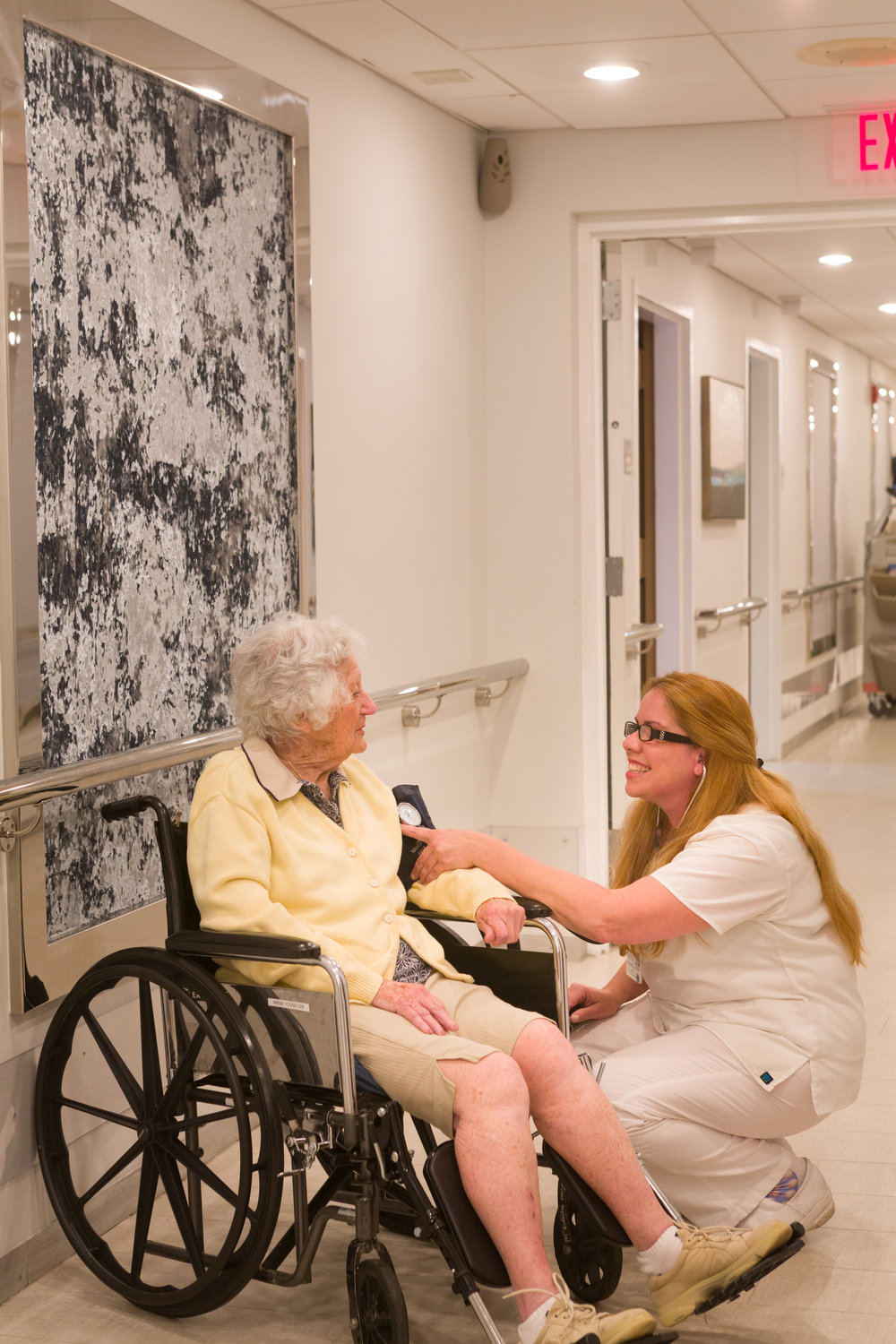 "One of Emerge's nurses checked on a patient in the center's hallway, dubbed ""Broadway"" by residents and staff."