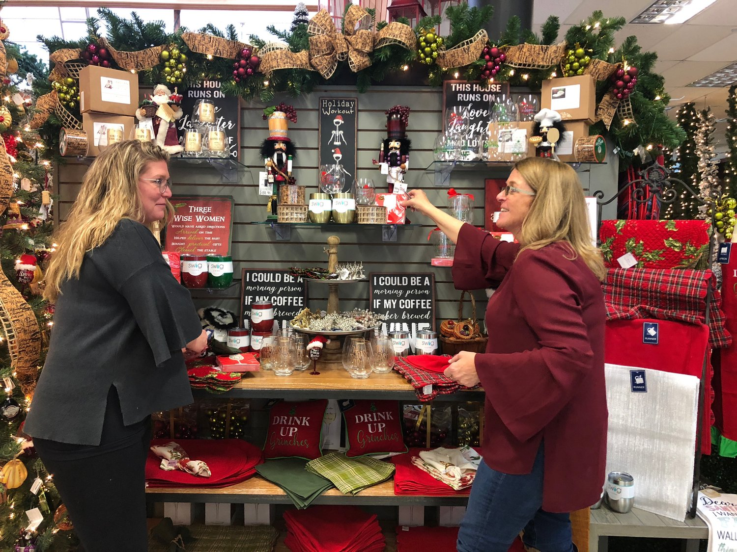 Owners of Dodds & Eder, Carrie Leopold, left, and Dottie Simons have worked to keep the Oyster Bay store well stocked, but it hasn't been easy.