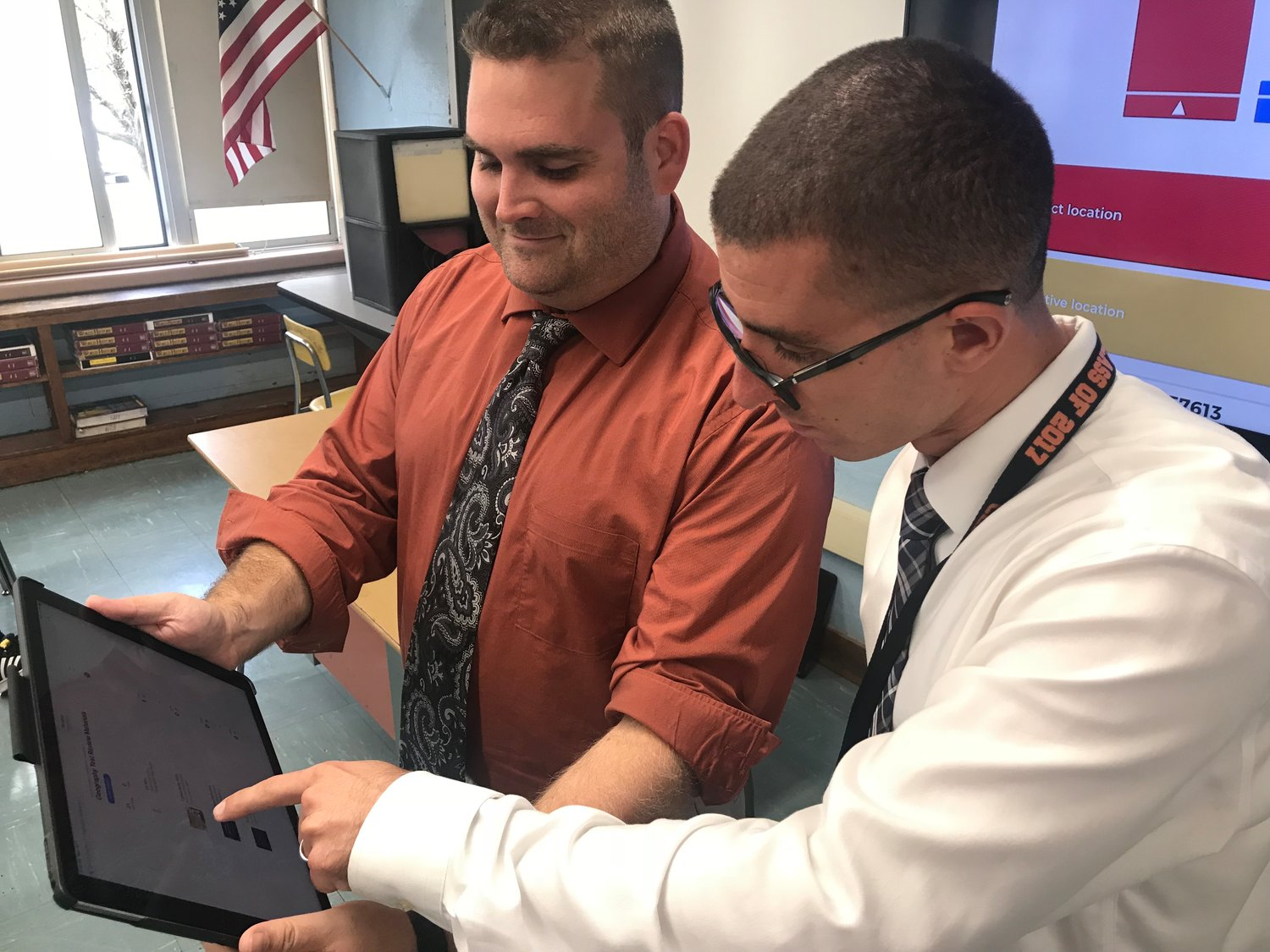 H. Frank Carey Assistant Principal Christopher Carmody worked with teacher Anthony Lapelosa during a district tech training session in September.