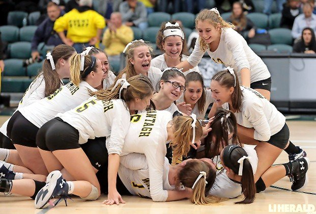 The Lady Warriors celebrated after outlasting Lynbrook in five sets to win the Nassau Class A girls' volleyball championship on Nov. 8.