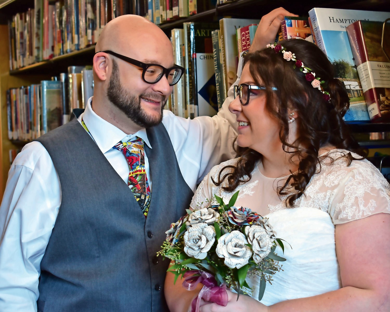 The bride's bouquet was handmade with comic book pages by a seller on Etsy.