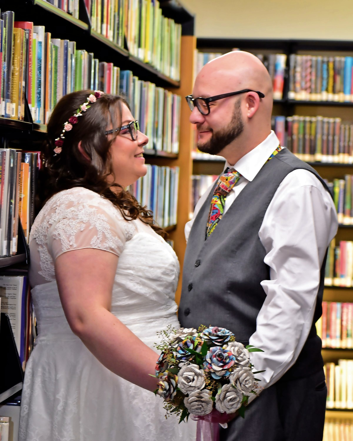 Newlyweds and comic book enthusiasts Tricia Balsan, 30, and Steve Schuster, 33, were married among the bookshelves of the Oceanside Library on Oct. 27.