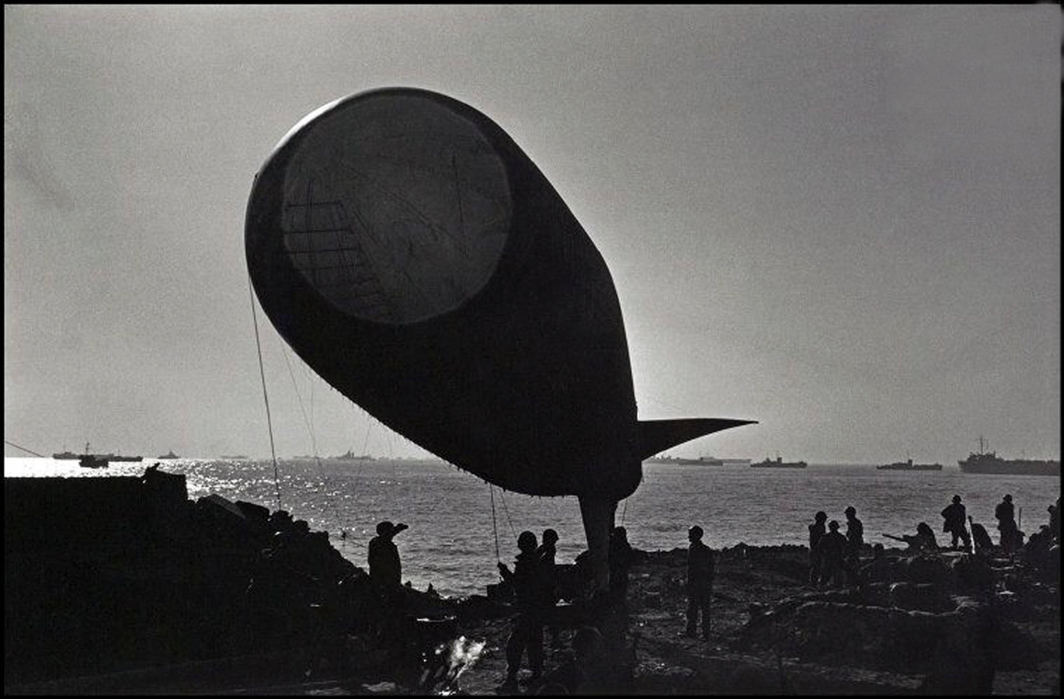 Soldiers worked to inflate a barrage balloon at the Anzio beachhead in 1944 to protect against air attacks. Albarella had been assigned to balloon duty for the invasion.