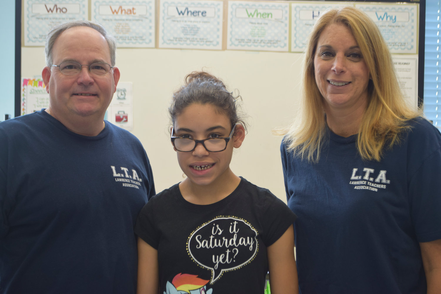 Seventh-grader Jade Suarez received cross-country coaching from Lawrence Middle School phys. ed. teachers Pat McQuillan, far left, and Cheri Donnelly-McQuillan.