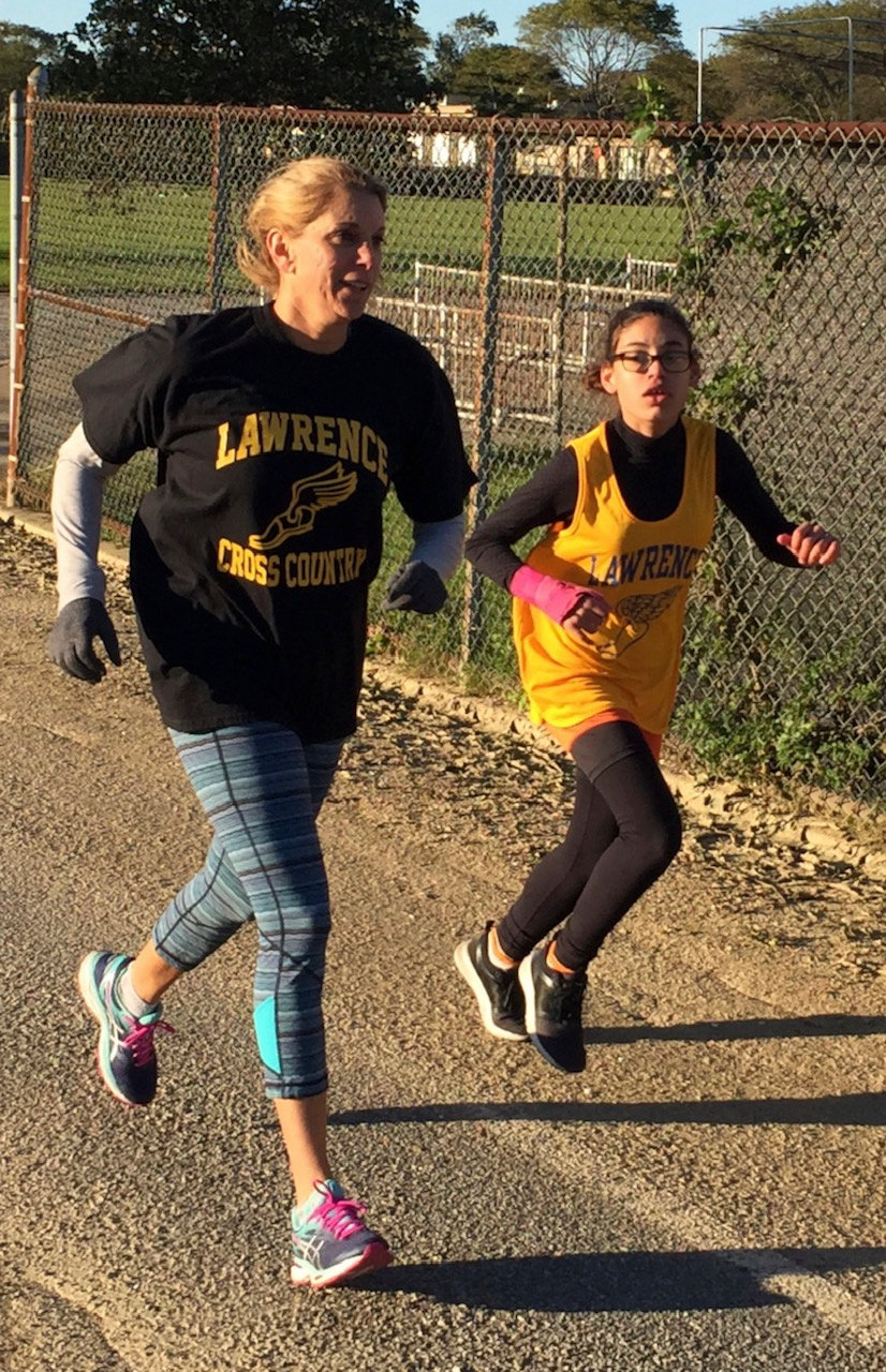 Lawrence Middle School phys. ed. teacher Cheri Donnelly-McQuillan ran all eight cross-country meets with Jade Suarez. Above, at the 2-mile Baldwin Park meet on Oct. 18.