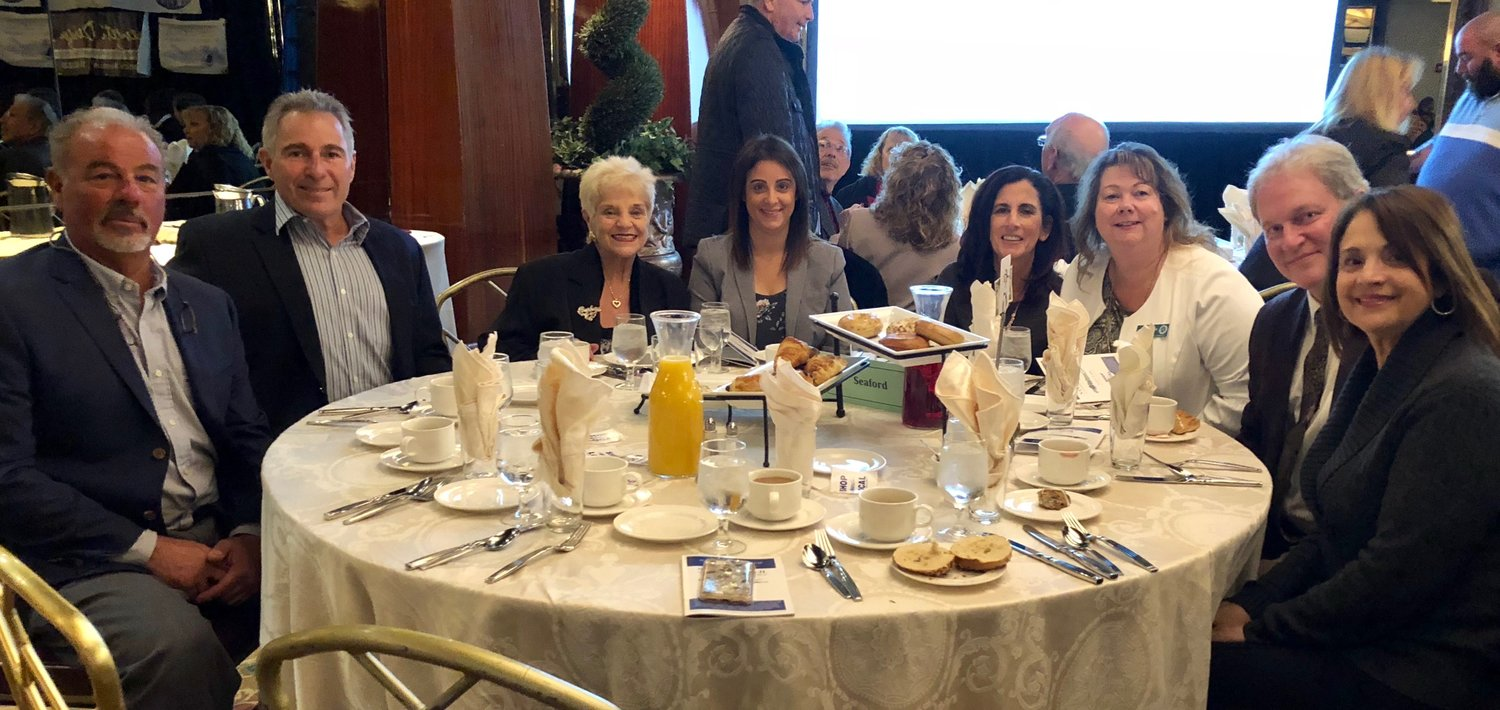 John Scannello and Ralph and Claudio Facchini were honored at the Nassau Council of Chambers of Commerce Breakfast on Oct. 19. Ralph Facchini, from left, John Scannello, Seaford Chamber of Commerce Directors Barbara Shane, Jennifer Menza and Christine Cillis, Chamber President Karen Cass, and Directors Robert Meade and Juanita Duran.