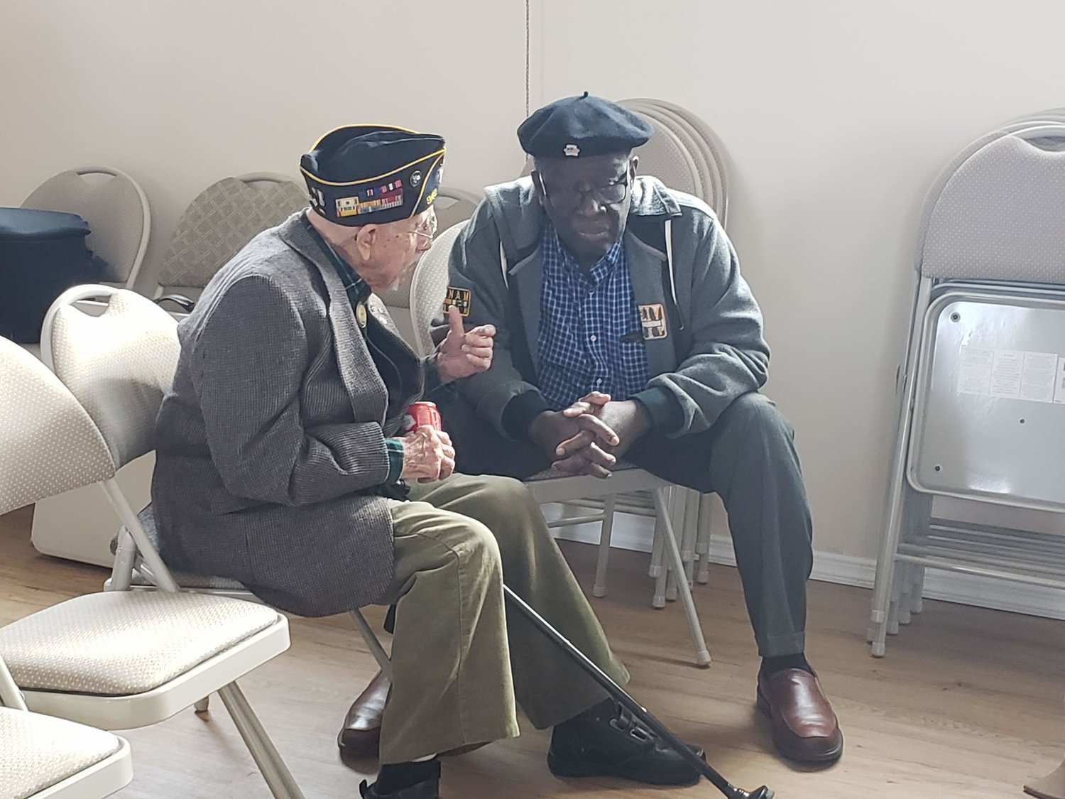 American Legion William Clinton Story Post 342's chaplain, Albert Klipfel, 92, left, a Navy veteran, and Army veteran Calvin Andrew, 72, talked about their time in the military after the Veterans Day program at the Freeport Recreation Center on Monday.