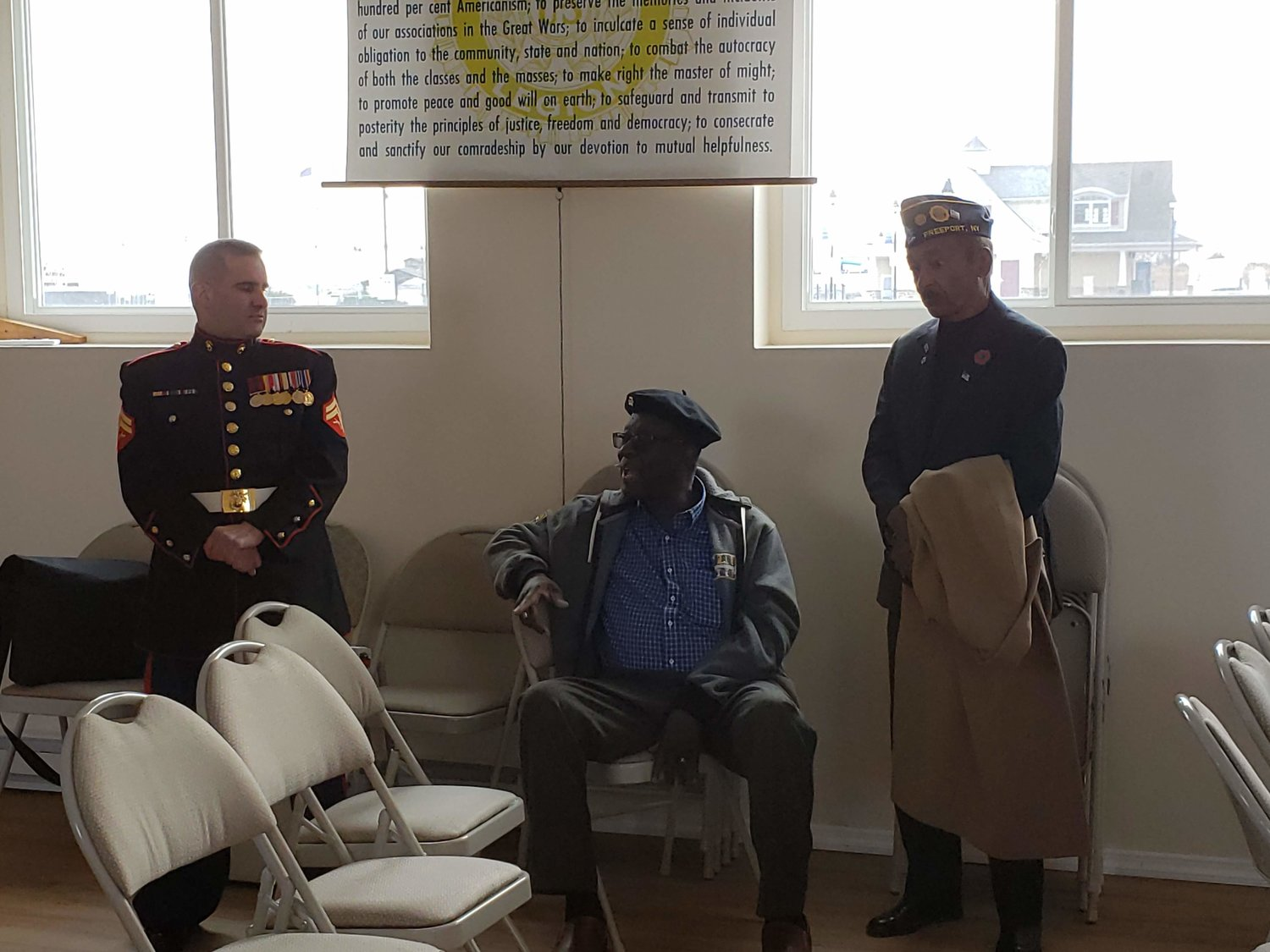 Marine Michael Panza, Army servicemen, Calvin Andrew and Richard Cromwell talked during the Veteran's Day barbecue luncheon at the Post.