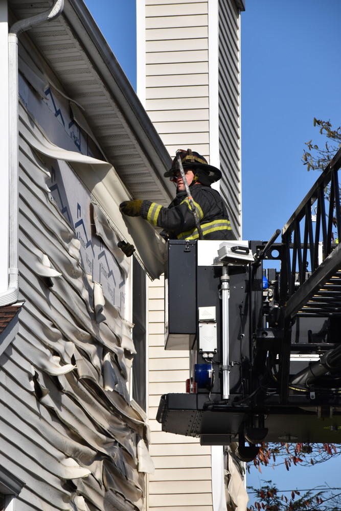 The intense heat from the fire melted the siding of a neighboring home, however, the EMFD prevented it from igniting.
