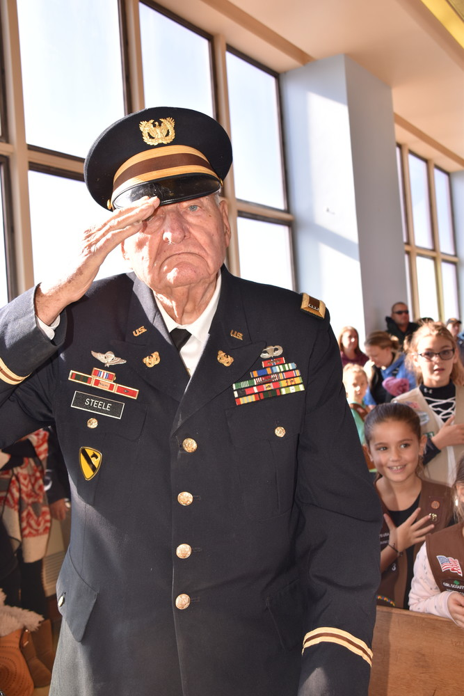 Daniel Steele, a U.S. Army veteran who served in World War II, saluted his fallen brothers and sisters.