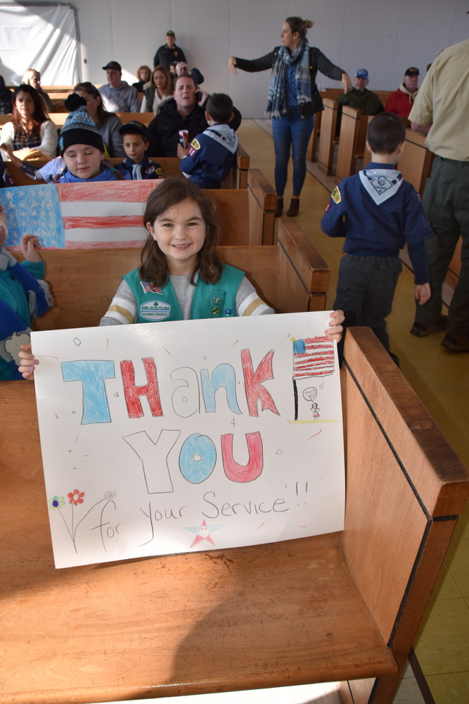 Anna McCarthy, 9, of Island Beach Girl Scouts showed off her sign thanking veterans for their service.
