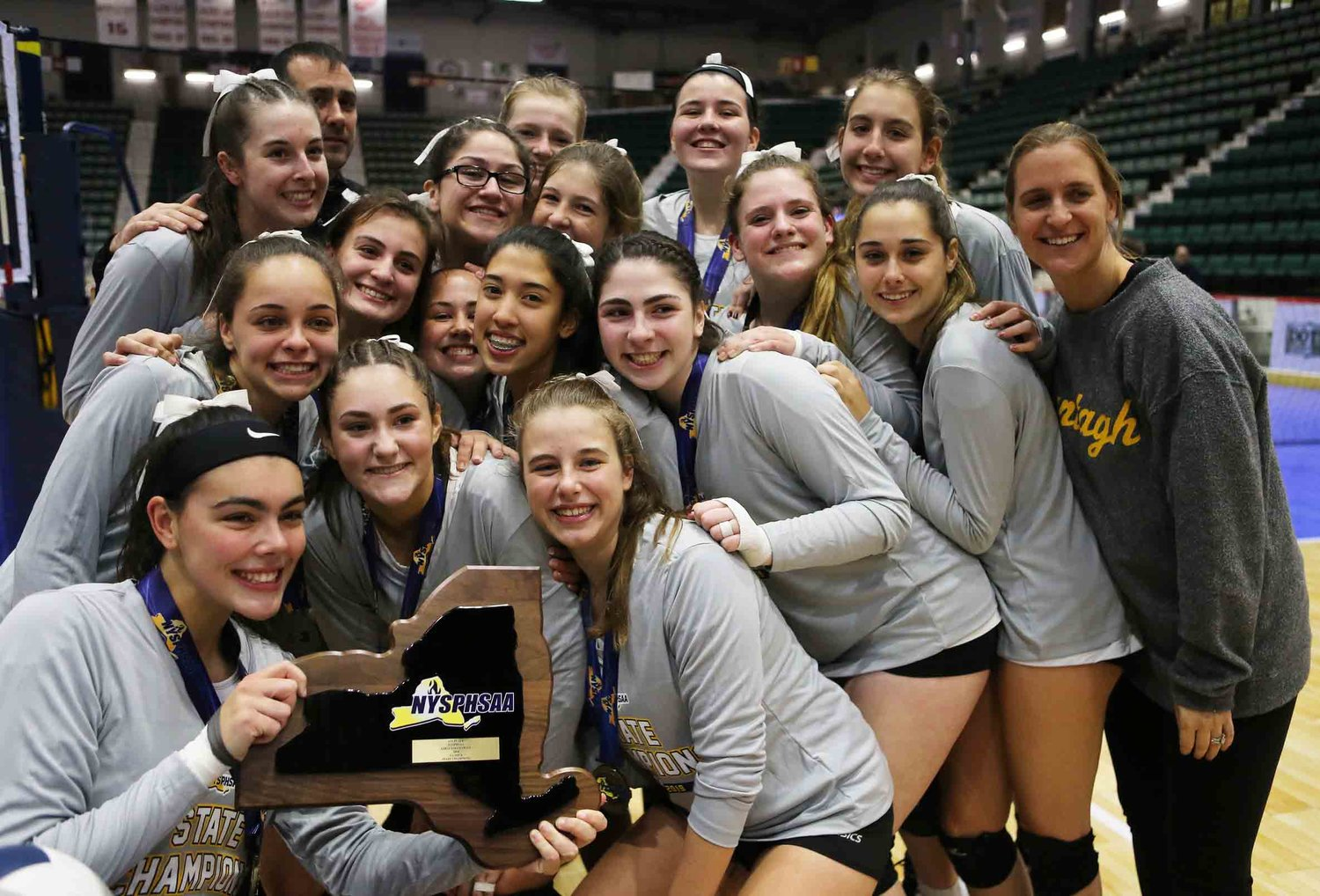 The Lady Warriors won a wild five-set marathon over Niagara Wheatfield to capture the NYS Class A title.