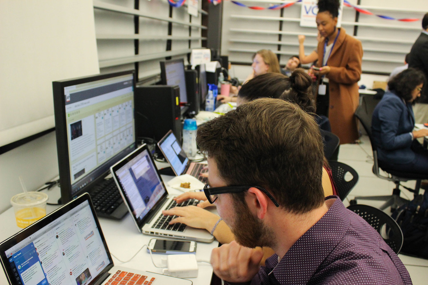 The staff of The Hofstra Chronicle updated social media with election results and began searching for angles for the next day's paper.