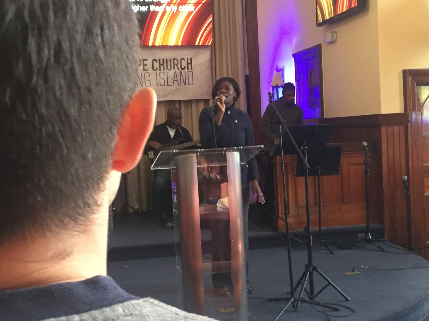 Jack Cimorelli, foreground, one of many Hofstra students who attend Hope Church, followed the lead of Worship Leader Rachel Pierre during the service.