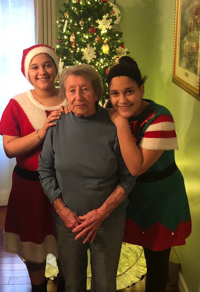 "Sasha Young's twin daughters Alexandra, left, and Alexis Acosta, with Betty Young, their great-grandmother, whom they too call ""Gammy."""