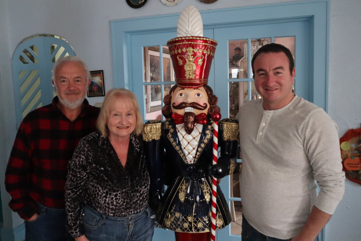 The Heides' Christmas display extends inside their house. Philip, right, takes pride in his nutcracker collection and bought this 6-foot one recently.