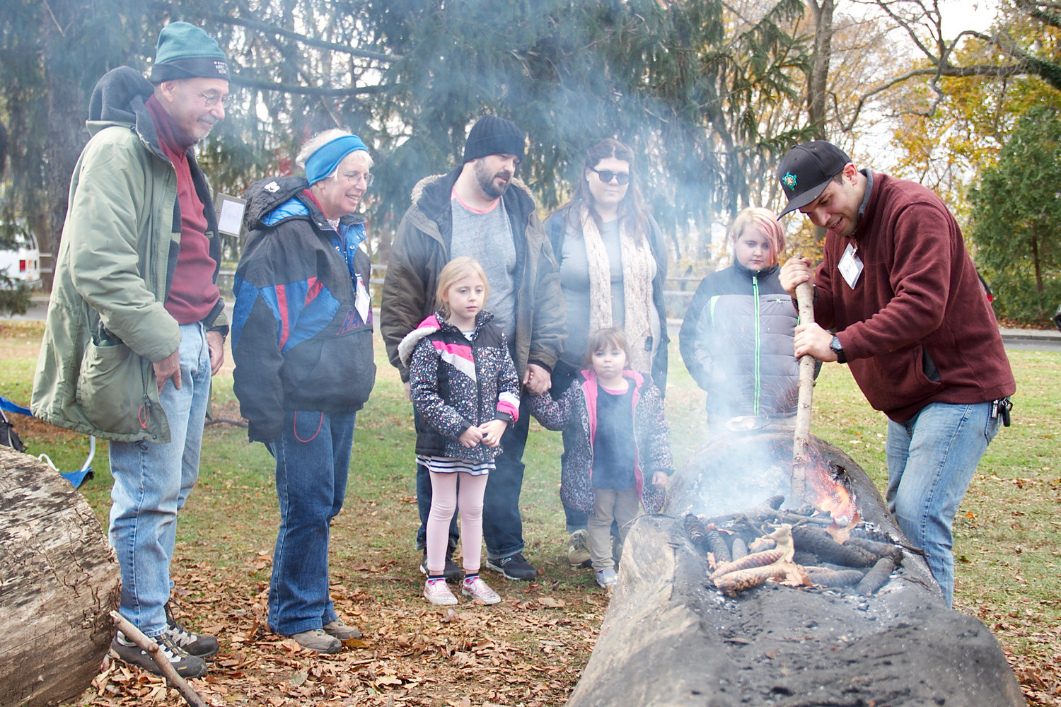 Visitors watched volunteer Steven Patrikis demonstrate how logs were burned and carved out for canoes at the annual Native American Feast at Garvies Point Museum and Preserve.