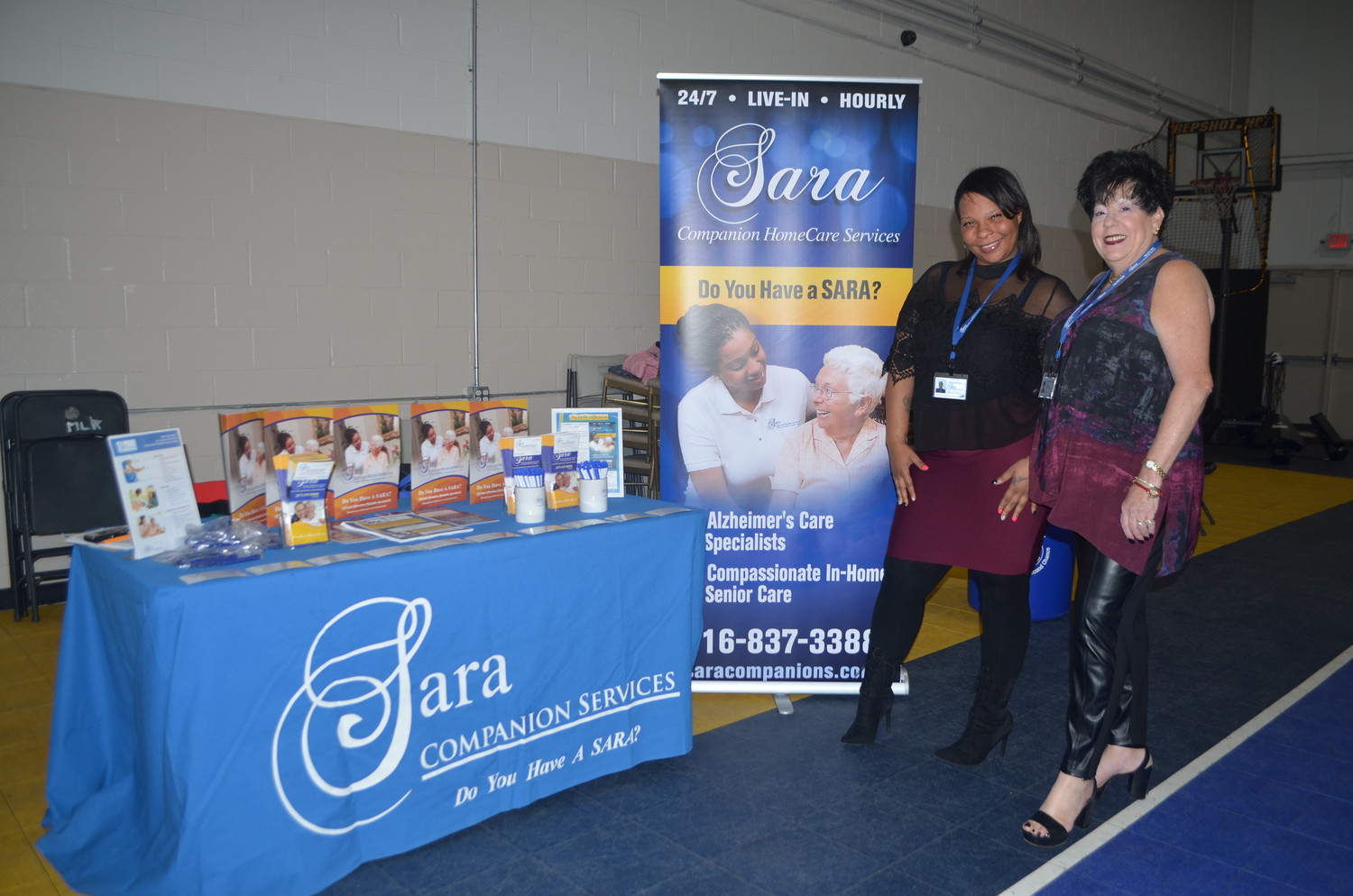 Sernomia Gay, a service coordinator for Sara HomeCare Services, left, and Roberta Lulov, a senior home care coordinator, presented information at the event about services they provide to elderly or disabled clients.
