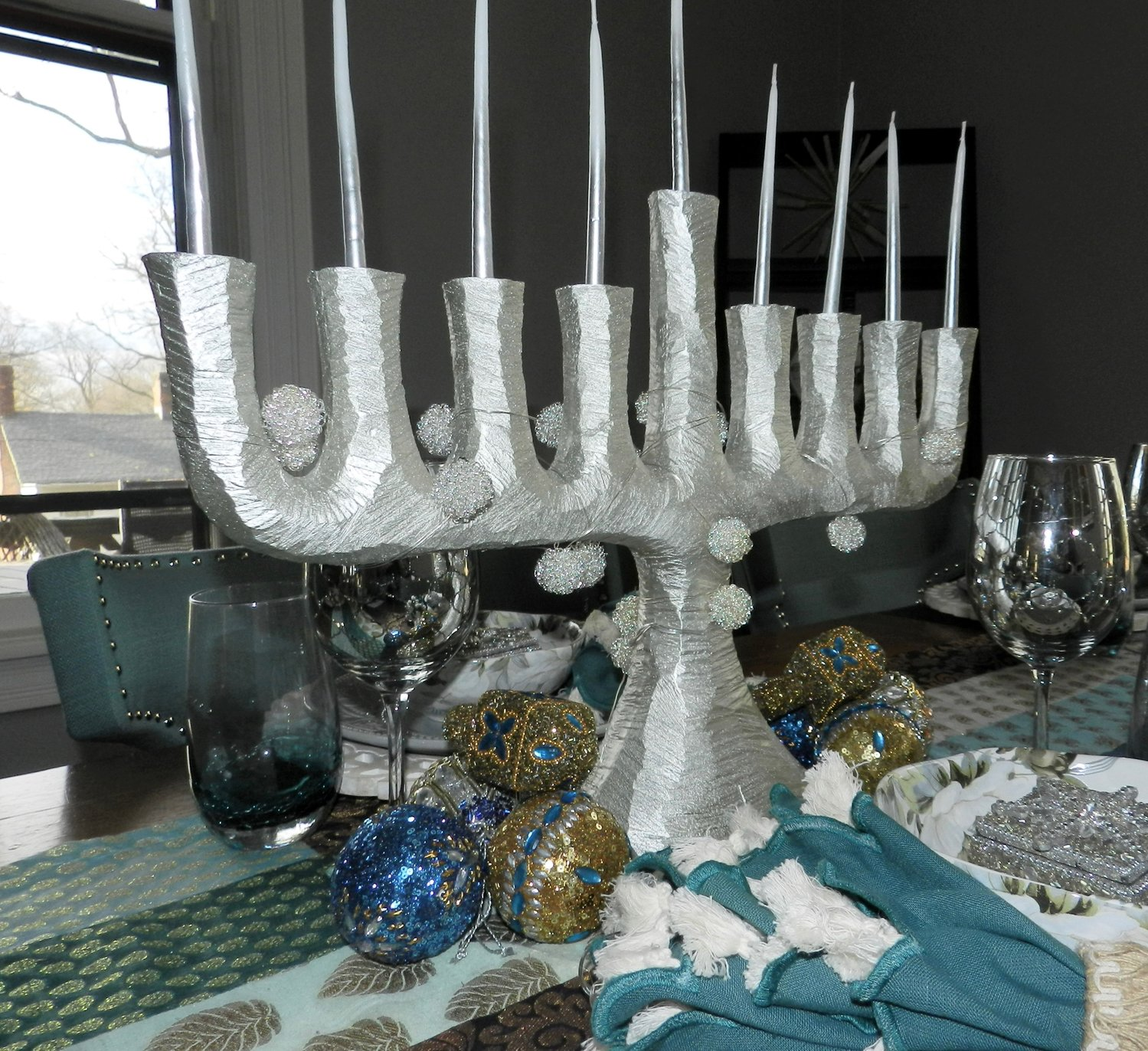 A Hanukkah-themed tablescape echoes the color scheme in Wehbeh's dining room.