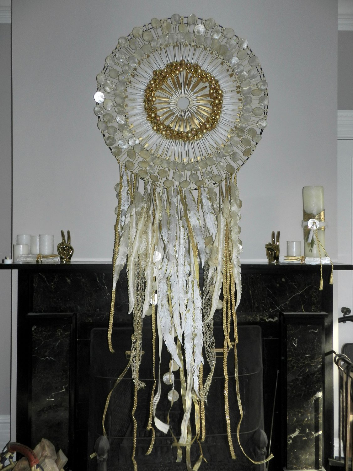 At the center of Wehbeh's living room is a handmade dream catcher. It was made by her event designer, Robert D'Alessandro, out of silk feathers and capiz shells.