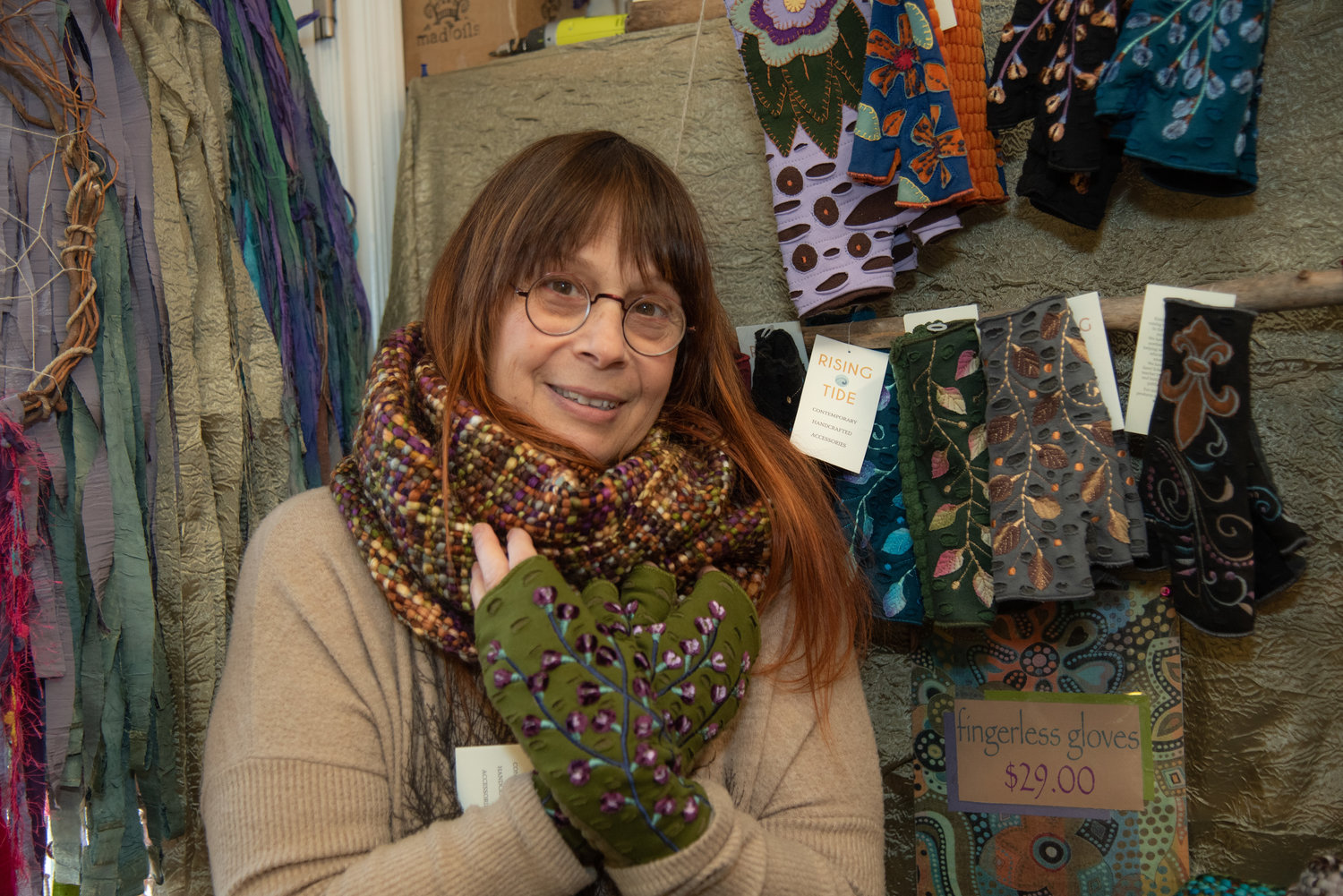 Diane Bard, who owns Peace Soap, warmed up for the winter with a pair of fingerless gloves.