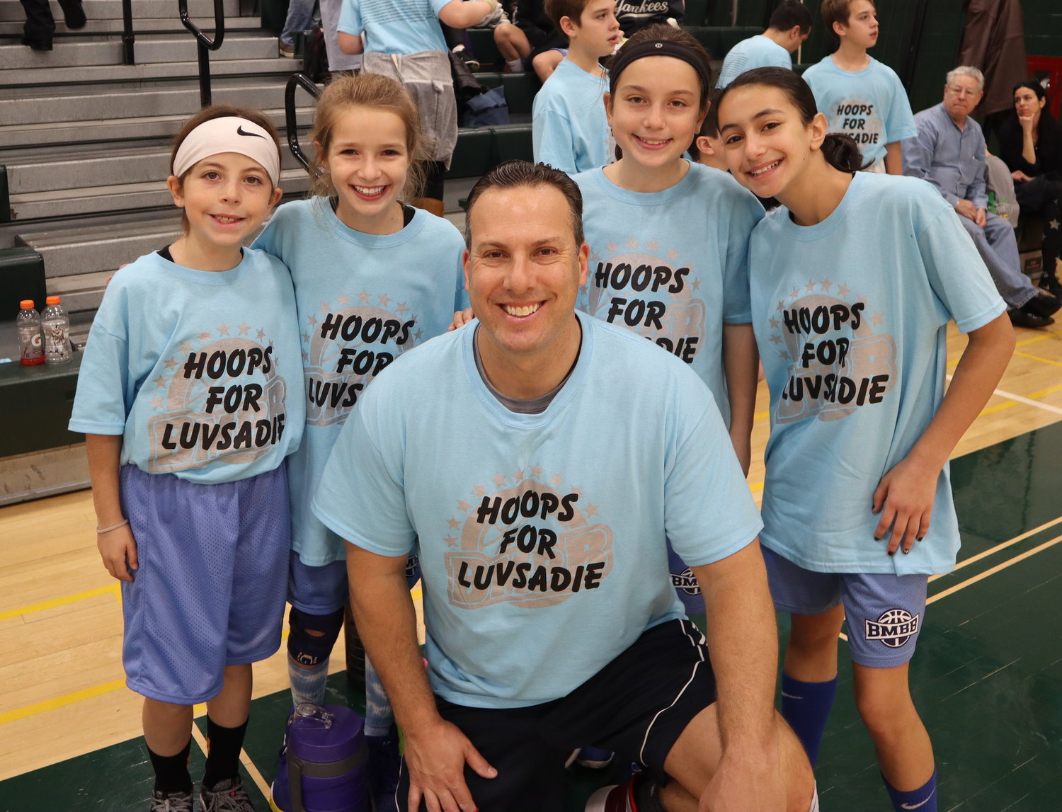 Bellmore-Merrick Basketball League organizer Adam Wohlleben, who coordinated Hoops for Sadie, with his daughter's team, the Fearsome Foursome.